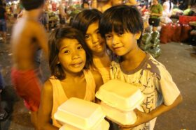 children with foor in containers